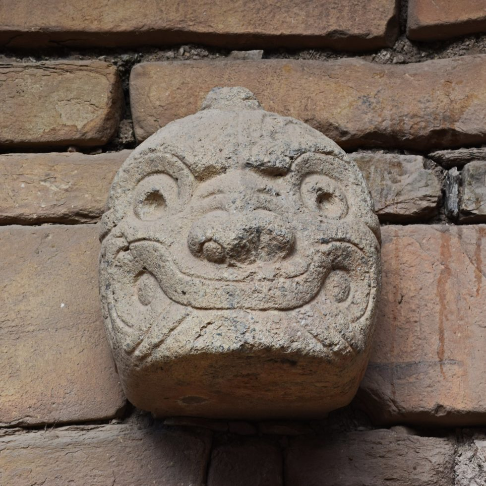 An image of a tenon head in the facade of the temple structure at Chavin